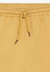 Soft Gallery - DORIA  - Tracksuit bottoms - golden apricot - 3