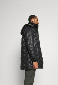 Diesel - W-RUSSELL-LONG-THERMO JACKET - Winter jacket - black - 3