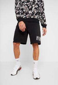 Puma - REBEL CAMO SHORTS - Short de sport - puma black - 0