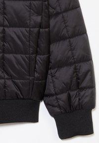 Calvin Klein Jeans - SQUARE QUILT LIGHT  - Winter jacket - black - 2