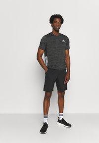 adidas Performance - OUTDOOR - T-shirt z nadrukiem - black - 1