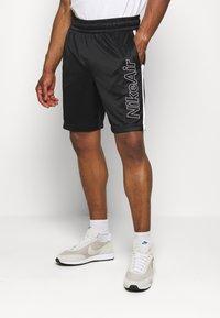 Nike Sportswear - Pantalon de survêtement - black/white - 0