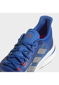 adidas Performance - SUPERNOVA + BOOST BOUNCE PRIMEGREEN RUNNING REGULAR SHOES - Neutral running shoes - blue - 9