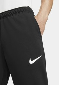 Nike Performance - PANT TAPER - Tracksuit bottoms - black/white - 3