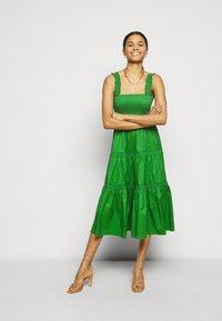 Tory Burch - SMOCKED RUFFLE DRESS - Day dress - resort green - 1