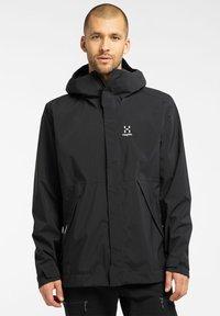 Haglöfs - TJÄRN JACKET  - Hardshell jacket - true black - 0