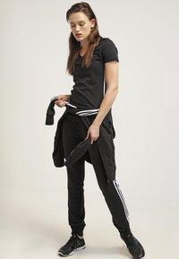 adidas Performance - ESSENTIALS  - Verryttelyhousut - black/white - 1