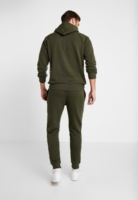 Champion - CUFF PANTS - Joggebukse - dark green - 2
