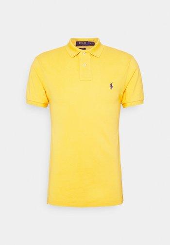 SLIM FIT - Polo shirt - gold bugle