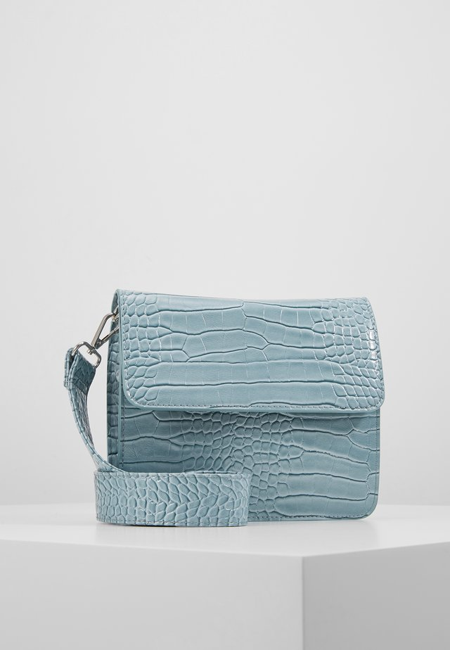 CAYMAN SHINY STRAP BAG - Across body bag - baby blue