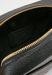 Coach - CAMERA BAG - Across body bag - black - 4