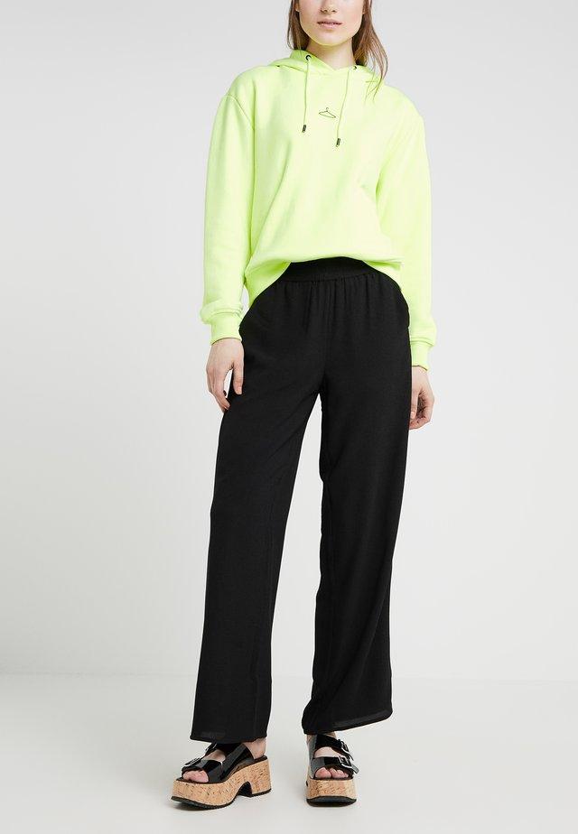 MOJA TROUSERS - Spodnie materiałowe - black