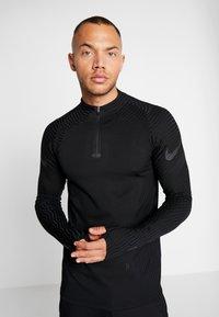 Nike Performance - DRIL - Camiseta de deporte - black - 0