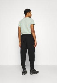 Calvin Klein Jeans - MICRO BRANDING PANT - Träningsbyxor - black - 2
