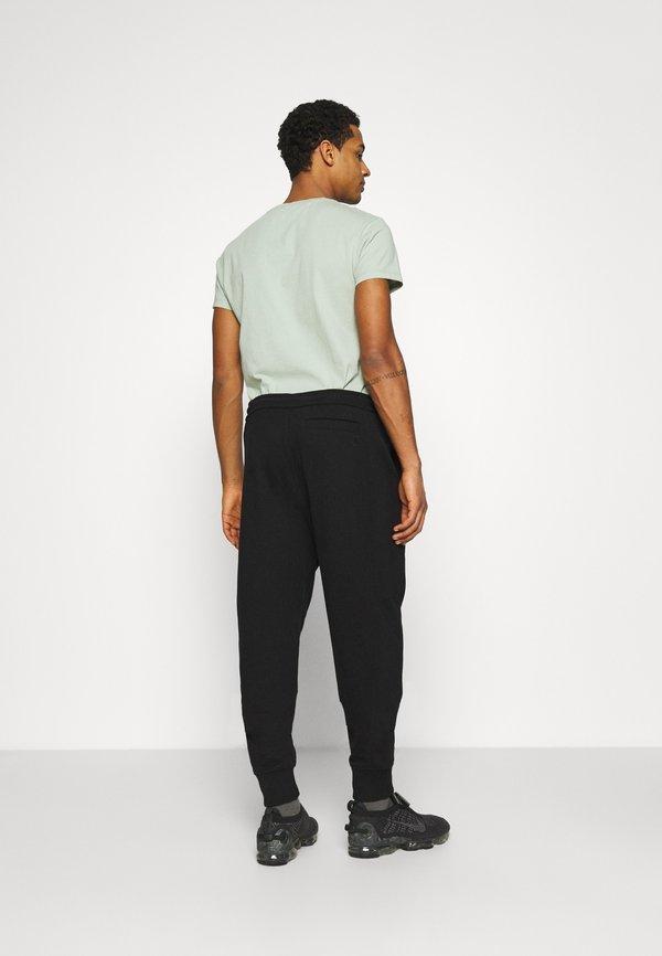 Calvin Klein Jeans MICRO BRANDING PANT - Spodnie treningowe - black/czarny Odzież Męska CPSY