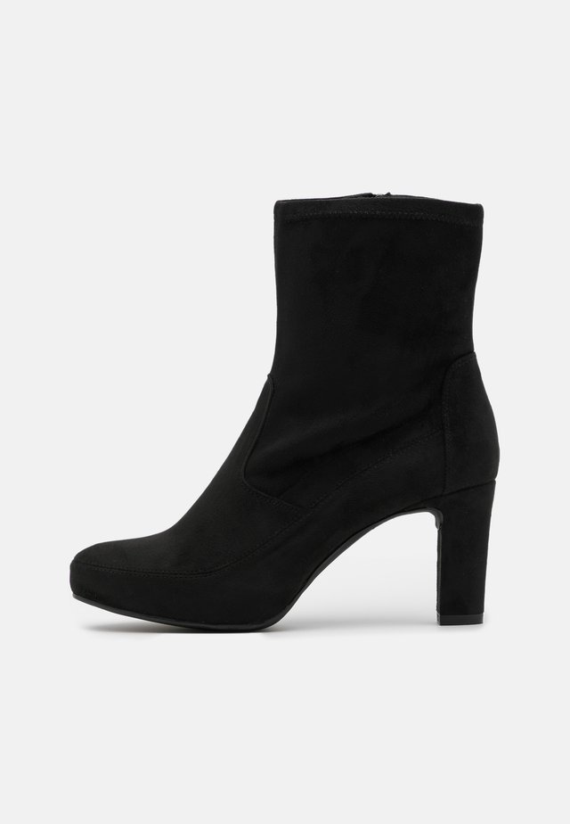 NOIA - Platform ankle boots - black