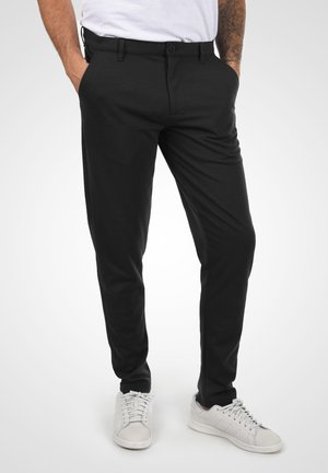 OLIVERO - Trousers - black
