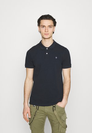 ROWAN BASIC - Polo shirt - total eclipse