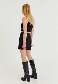 PULL&BEAR - MIT SCHLITZ - A-line skirt - black - 2