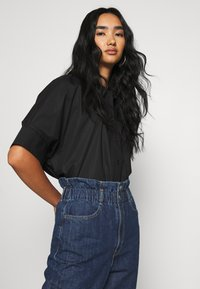 Levi's® - HIGH WAISTED PAPERBAG - Jeans relaxed fit - short fused - 3