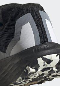 adidas Performance - TERREX TWO FLOW - Stabilty running shoes - savannah/core black/hi-res yellow - 11