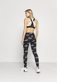 Puma - AMPLIFIED LEGGINGS - Collants - black - 2