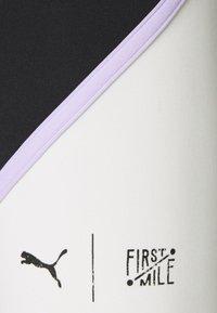 Puma - TRAIN FIRST MILE BIKER SHORT - Medias - black/eggnog - 2