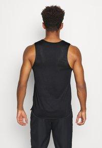 Nike Performance - MILER TANK - Sports shirt - black/sail/silver - 2