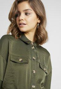 Vero Moda - VMJANE DRESS - Shirt dress - ivy green - 6