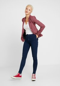 Topshop Tall - HOLDING POWER JONI - Jeans Skinny Fit - indigo - 1