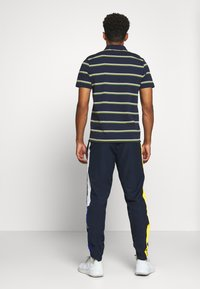 Lacoste Sport - TENNIS PANT - Tracksuit bottoms - navy blue/wasp-white-cosmic - 2