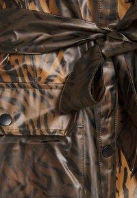 Cream - SEVICA RAINCOAT - Waterproof jacket - brown - 2