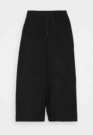 MALEKI - Shorts - black