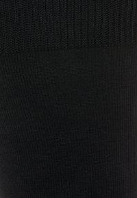 FALKE - AIRPORT KNIESTRÜMPFE SCHURWOLLE-MIX - Knee high socks - black - 1
