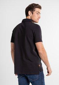 Timberland - BOOT LOGO - Polo shirt - black - 2