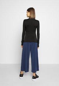 Monki - CILLA FANCY TROUSERS - Trousers - blue dark navy - 2