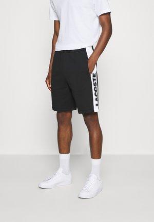 Pantalones deportivos - noir/blanc