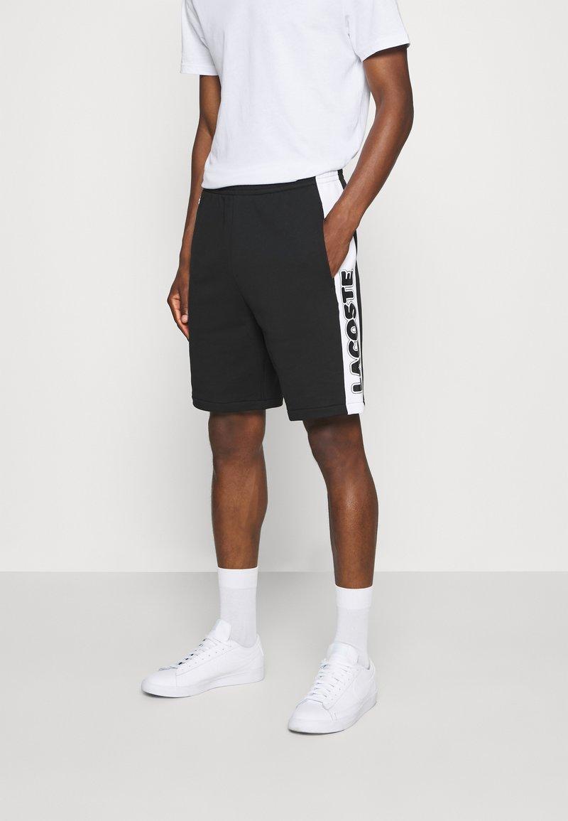 Lacoste - Spodnie treningowe - noir/blanc