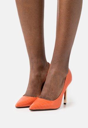 Klassiske pumps - orange