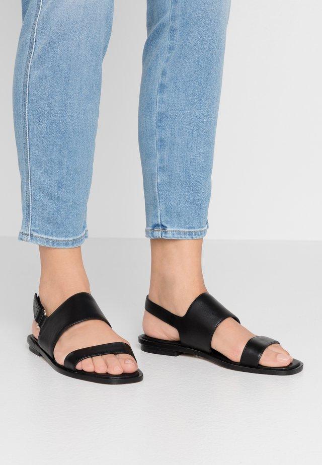 SULA - Sandals - black