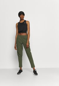 adidas Performance - TRAIN PANT - Tracksuit bottoms - olive - 1
