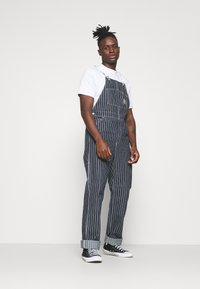 Carhartt WIP - TRADE OVERALL - Jeans Relaxed Fit - dark navy/wax rinsed - 1