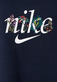 Nike Sportswear - TEE NATURE PLUS - T-shirt print - obsidian - 6