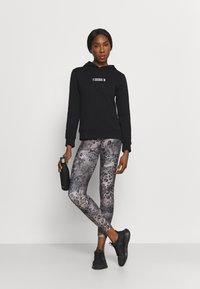 Calvin Klein Performance - HOODIE - Hoodie - black - 1