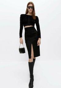 Uterqüe - Pouzdrová sukně - black - 1