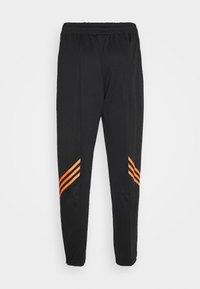 adidas Originals - TRACK PANT UNISEX - Tracksuit bottoms - black/trace orange - 7