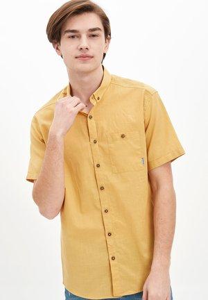 Vapaa-ajan kauluspaita - yellow
