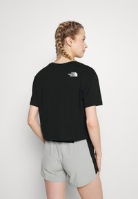 The North Face - CROPPED EASY TEE  - Print T-shirt - black - 2