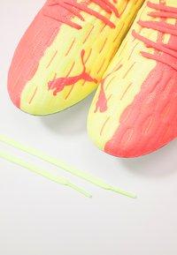 Puma - FUTURE 5.1 NETFIT OSG FG/AG - Moulded stud football boots - energy peach/fizzy yellow - 5