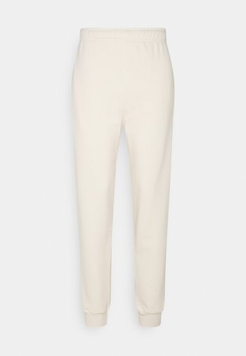 RILEY JOGGER - Tracksuit bottoms - weiß